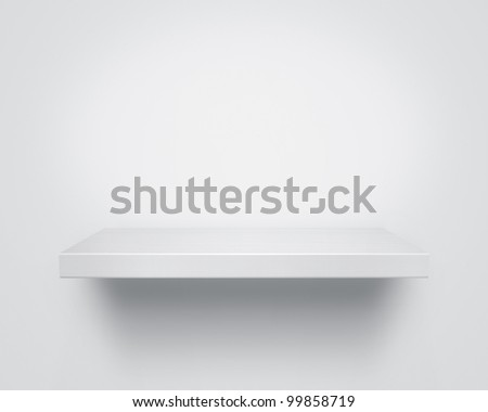 Empty white wooden shelf at the wall with copy space - stock photo