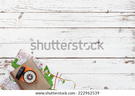 empty white wooden table with tools for adventure, top view - stock photo
