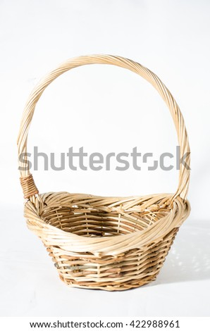Empty wicker basket isolated on white