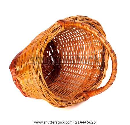 Empty wicker basket. Isolated on white background.  - stock photo