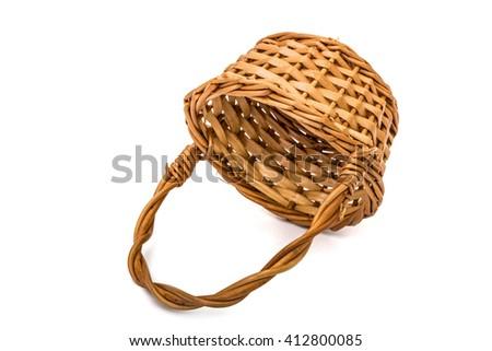 Empty wicker basket, isolated on white background - stock photo