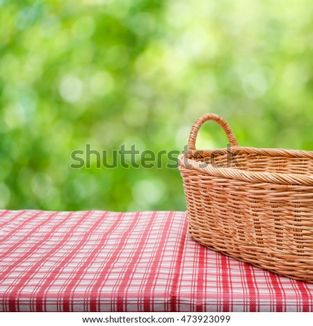 Empty wicker basket on the table with the natural background.