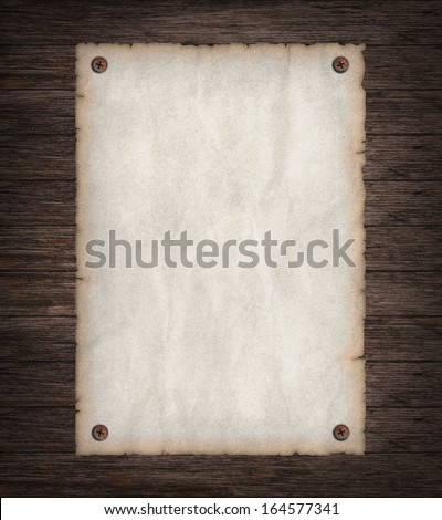 Empty Wild West wanted poster on old wooden wall - stock photo