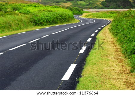 Empty winding country road in Brittany, France - stock photo