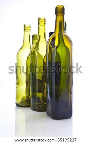 Empty wine bottles backlited - stock photo