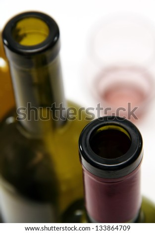 empty wine bottles green and clear wine glass for alcoholic beverages. - stock photo