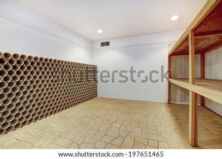 Empty wine cellar with wooden shelves and wine storage unit