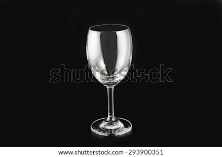 Empty wine glass. isolated on a black background - stock photo