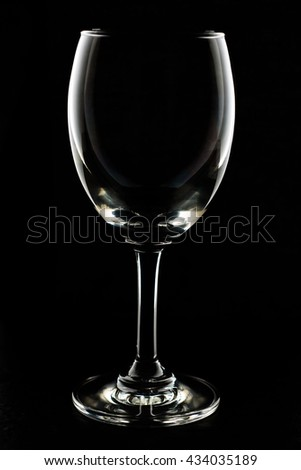 Empty wine glass isolated on black - stock photo