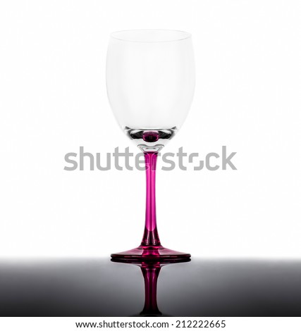 Empty wine glass on a white background with reflection