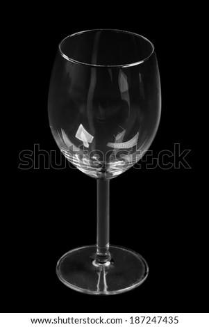 Empty wine glass on black background - stock photo