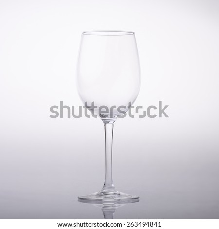 Empty wine glass on light background - stock photo