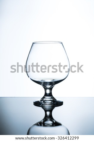empty wine glass on the glass table and white background