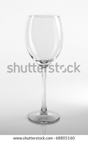 Empty wine glass on the white reflective table