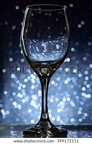 empty wine glass stand on blurred bokeh background - stock photo