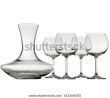 Empty wine glasses and decanter isolated on white background - stock photo