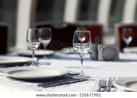 Empty wine glasses and plate on the dining table  - stock photo