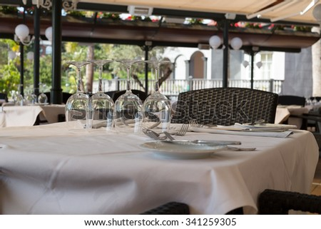 Empty wine glasses on a table in a restaurant. - stock photo