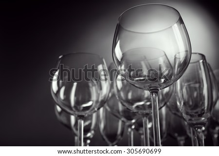 Empty wine glasses on gray background