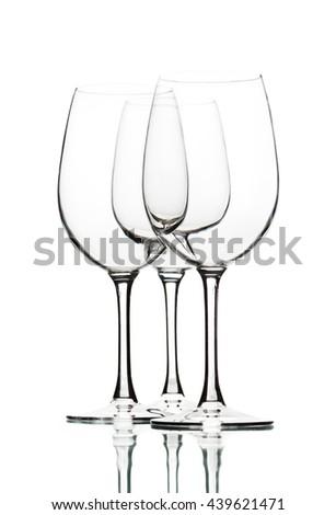 Empty wine glasses on white - stock photo