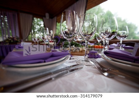 Empty wine glasses set in restaurant