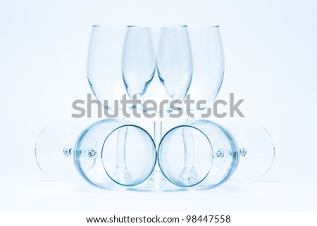 Empty wine glasses stand and lie symmetrically - stock photo