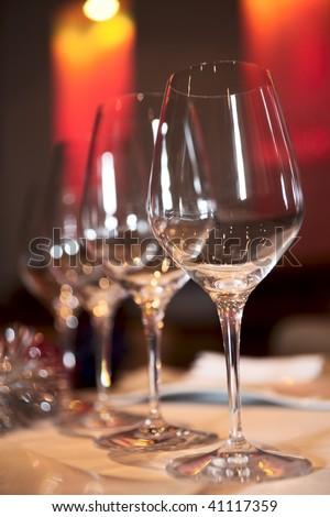 Empty wineglasses in festive red light on restaurant table - stock photo