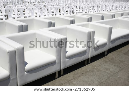 Empty with white armchairs and plastic chair outdoor event - stock photo