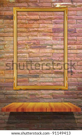 Empty wood shelf and frame on stone wall with down light - stock photo