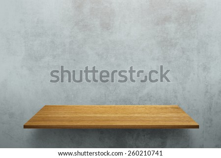 Empty wood shelf on loft style wall texture