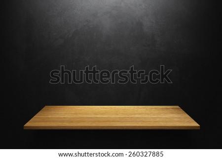 Empty wood shelf on loft style wall texture  - stock photo