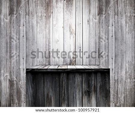 Empty wood shelf on old wall - stock photo
