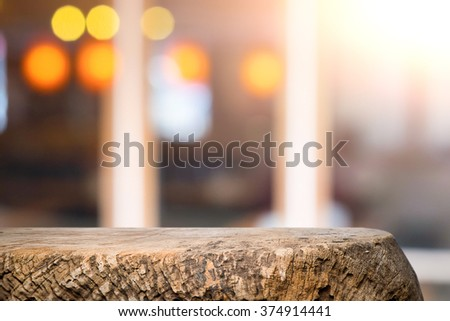 Empty wood table and blurred booked cafe light background. product display template. Business presentation. - stock photo