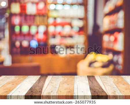 Empty wood table and blurred cafe light background. product display template.Business presentation. - stock photo