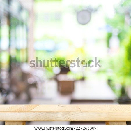 Empty wood table and blurred garden cafe light background. product display template.Business presentation - stock photo
