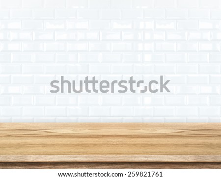 Empty wood table and ceramic tile brick wall in background. product display template - stock photo