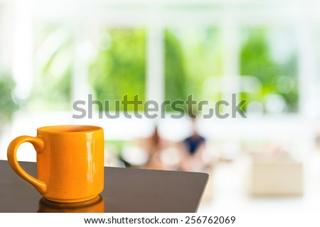 Empty wood table and Coffee shop blur background with bokeh image. - stock photo