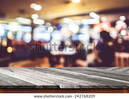 Empty wood table top with restaurant blur with bokeh background,Product display template - stock photo