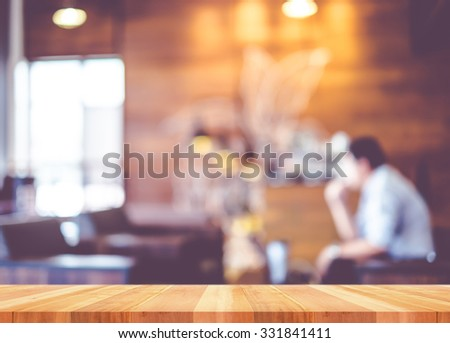 Empty wood table with blur coffee shop background,Mock up Template for display of product - stock photo