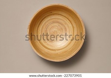 Empty Wooden Bamboo Bowl isolated on Grey Background with Real Shadow. Top View with Copy Space for Text - stock photo