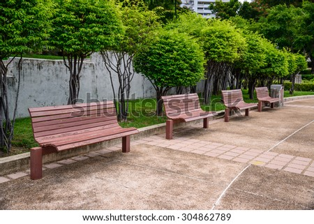 Empty wooden bench chair in the park