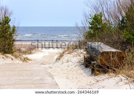 Empty wooden bench near the Baltic sea in Jurmala, Latvia  - stock photo