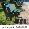 Empty wooden benches in order - stock photo