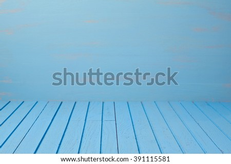 Empty wooden blue table over blue wall. Kitchen background - stock photo