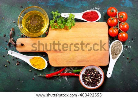 empty wooden board  with various products for cooking on rusty background
