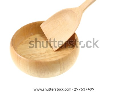 Empty wooden bowl and spoon  on white background.