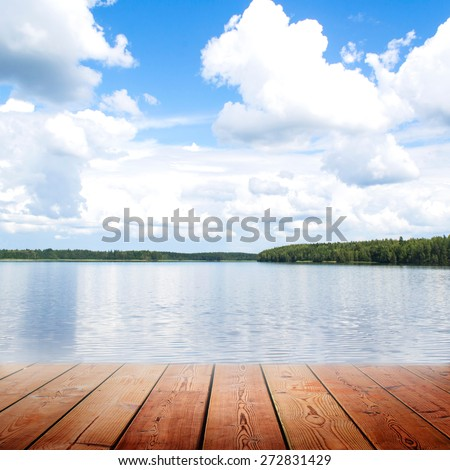 Empty wooden bridge and riverwith blue sky  background - stock photo