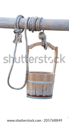 empty wooden bucket with rope holding on timber ,clipping path on background - stock photo