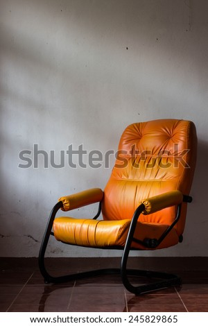 empty wooden chair ,chair of loneliness,sofa of loneliness - stock photo
