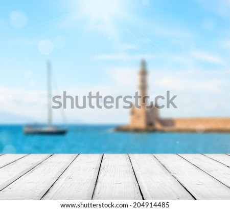 Empty wooden deck table with copyspace and bokeh background. - stock photo
